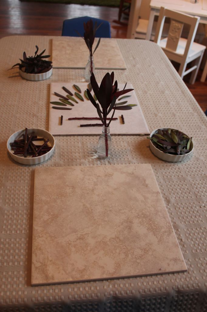 "Natural materials with ceramic tiles as a base for the transient art - at The Nest Nursery School ("",)"