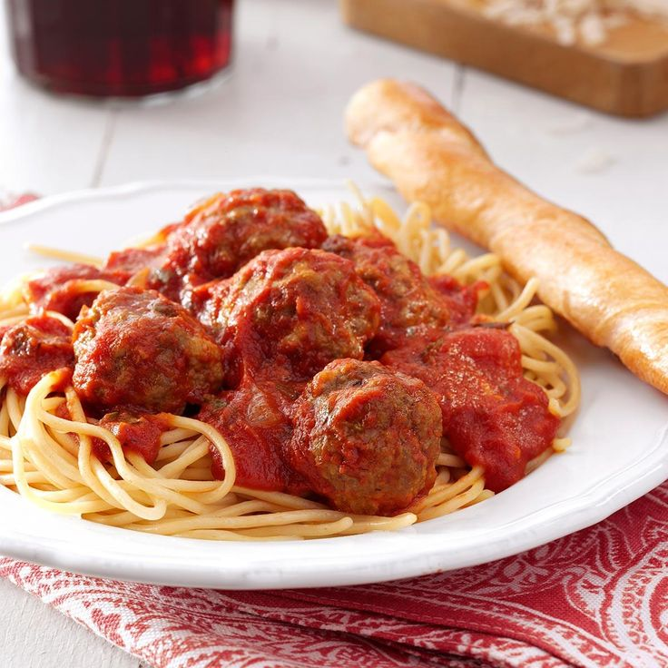 Best Spaghetti and Meatballs Recipe -One evening, we had unexpected company. Since I had some of these meatballs left over in the freezer, I warmed them up as appetizers. Everyone raved! This classic recipe makes a big batch and is perfect for entertaining. —Mary Lou Koskella, Prescott, Arizona