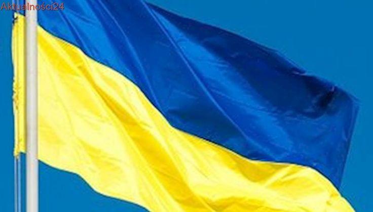 Ukraina. Granat na fasadzie Centrum Kultury Polskiej