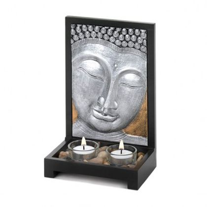 Creating a space thats equal parts calming and gorgeous is easy with this beautiful candle holder. The wood frame holds two clear glass tealight candle cups surrounded by polished stones, and the standing plaque features an artistic Buddha face finished in gleaming silver. Tealight candles not included.