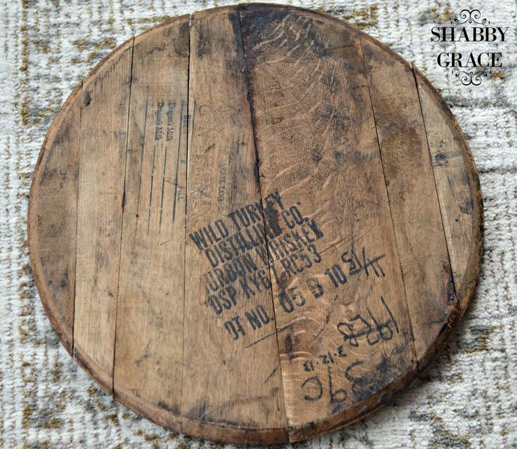 I've had a whiskey barrel top laying around since last summer.  I knew I had to purchase it at the time and inspiration would come to me sooner than later.  Wel…