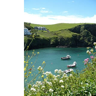 Port Isaac, Cornwall  (where 'Doc Martin' is filmed. My husband and I love that show and would love to visit one day.)