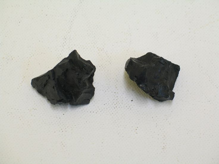 Two pieces of coal found in the pocket of Service Dress jacket belonging to Ray J.  Linton, probably meant as a good luck charm. From the collection of the Air Force Museum of New Zealand.