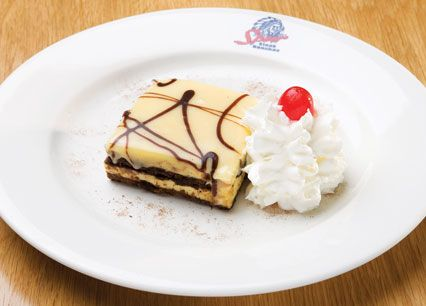 Fudge Picasso. Layered dark chocolate sponge with white chocolate, vanilla mousse and fudge chunks, draped with white chocolate ganache at Spur Steak Ranches   http://www.spur.co.za/menu/desserts