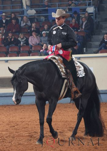 "Elis A Sleepin, Jr World Champion Western Riding      As the championship neck wreath was fastened around the 2006 black gelding's neck, Leonard motioned to  remove the bridle and fastened the wreath around ""Eli's"" neck.  Leonard loped around using the neck wreath to steer and eventually removed that as well, changing leads every two strides."