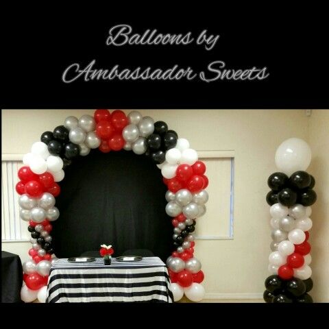 Black White Red And Silver Balloon Arch And Columns In