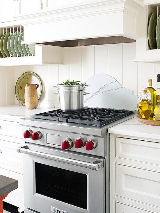 Transform your drab backsplash into one that pops with style. Draw interest to your backsplash by using recycled glass tiles, opting for flat-front cabinets and incorporating translucent tile.