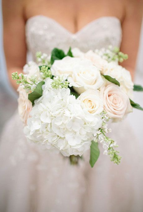 Brides: Bouquet With Hydrangeas, Roses, and Greenery. It should come as little surprise that many brides love including fluffy hydrangeas in their big day bouquet. Not only is this round bloom a showstopper on its own or mixed with other petals, it's also super affordable in summer months when the colorful flowers are in season. While the out-of-season cost does rise, with such a full shape, you'll need fewer stems to make a major statement.