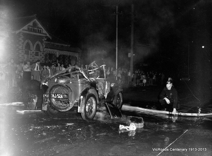 Fireman extinguishing a car on Nicholson St 1955. From the VicRoads archives - acknowledging our Centenary 1913-2013
