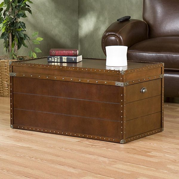 Trunk coffee table to increase storage space for linens