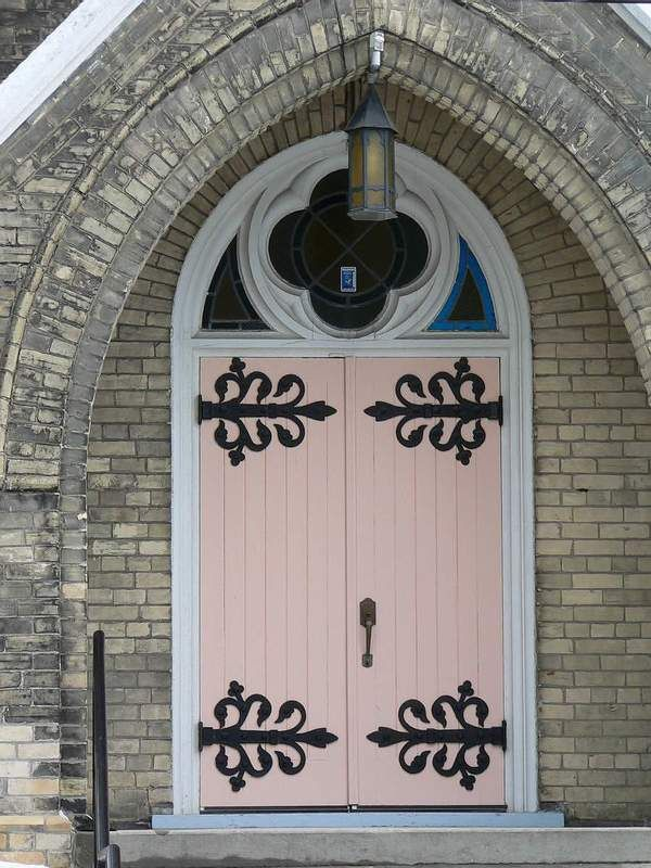 The beautiful blush pink door on this Ontario, Canada church makes this entryway feel oh' so romantic. travel. Canada. doors of the world. church doors.