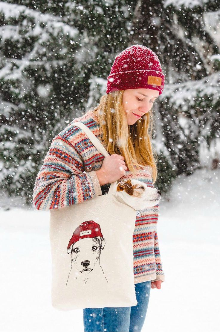 A JRT Doggo and her Mom in a snow storm. Ethically and ecologically made sturdy canvas tote bag. Made of 100% recycled cotton under CSR certificate. Check it out!