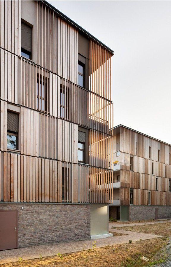 Der Lucien Rose Complex besticht durch seine einzigartige Verwendung von Holz. Visualisiere o