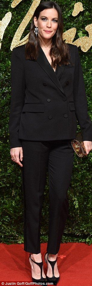 Liv Tyler stuns in sophisticated black suit and towering heels #dailymail