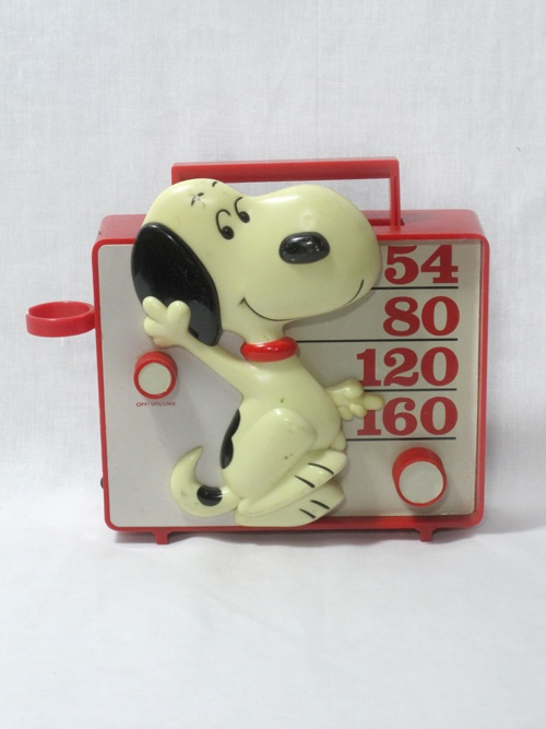 Vintage 1970's Snoopy transistor radio. Got one of these for Christmas one year. It had a microphone. My brother took it apart to see how it worked not long after I got it and that was that.
