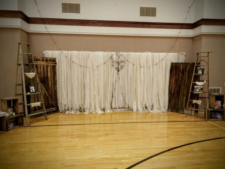 Rustic Wedding Back Drop.   Vintage Orchard Ladders,  barn Doors,  Lace Strip Curtains,  Barbwire Heart, Wood Crates.