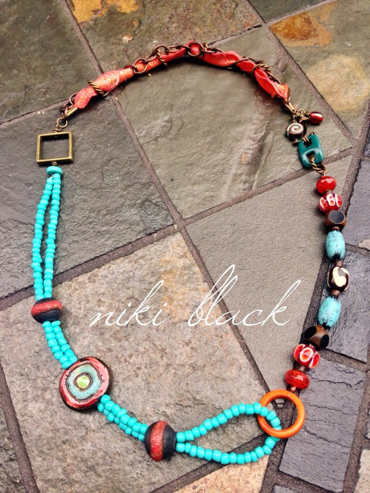 Made this necklace (inspired by one of Lorelei Eurto's) using ceramic beads (Classic Bead), polymer beads (graceful willow beads), vintaj brass chain, recycled sari ribbon, glass beads and more.