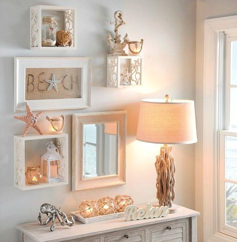 Coastal gallery wall with cube shelves that have starfish and shell cutouts: http://www.completely-coastal.com/2015/08/coastal-wall-cube-shelves.html