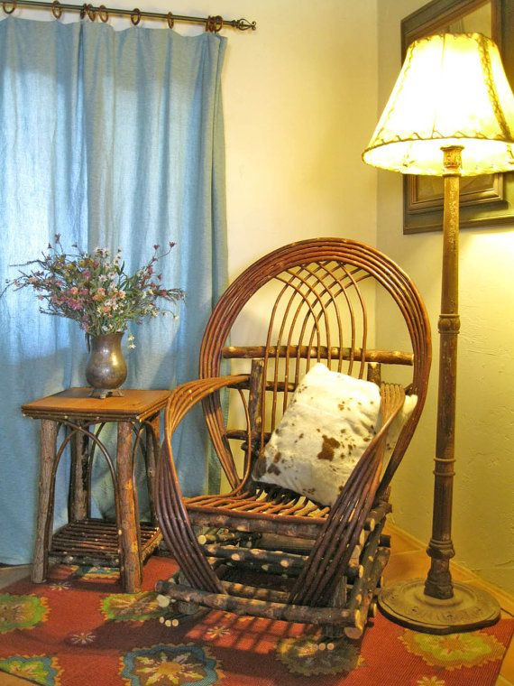 Rustic willow furniture looks nice in a cabin or cottage, especially paired with vintage style, Shabby Chic cushions.