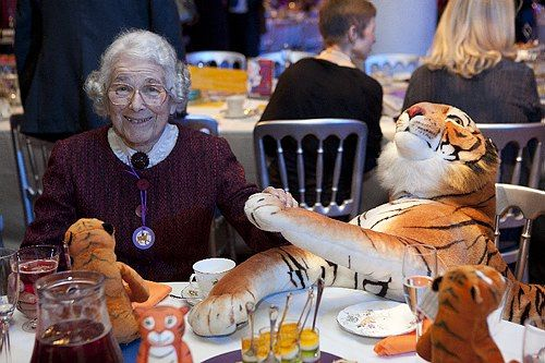 Judith Kerr, The Tiger Who Came To Tea author, enjoying a cup of tea with a tiger. #ImagineFest