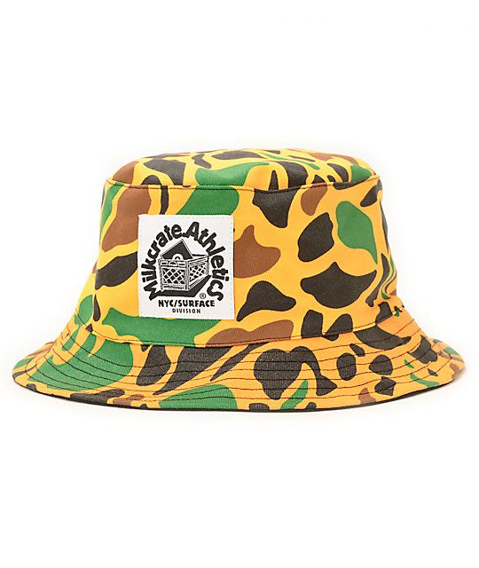 Make your headwear stand out by copping the Milkcrate orange camo bucket hat. Keep the sun out of your eyes with the wide brim on an all-over orange camo print colorway. Before your next adventure grab the Milkcrate orange camo bucket hat for a perfect co