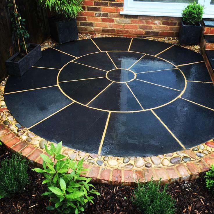 Black Limestone Circle edged with Caledonian Cobble Mosaic & Reclaimed Brick #paving