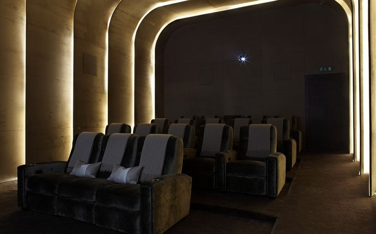 We really like the hidden lighting and curved ceiling in this private cinema room
