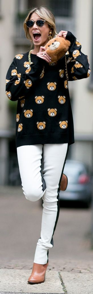 Milan Fashion Week street style: Helena Bordon wearing Moschino collection bear print sweater and purse