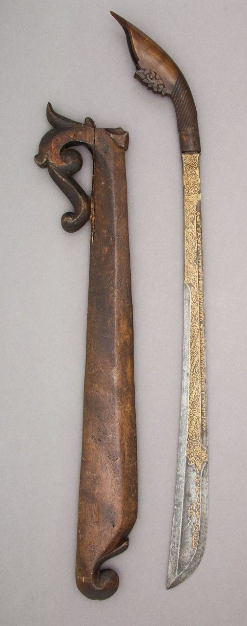 Sword (Rudus) and Scabbard. Dated: 1835. Inlayer: Muhammad Salih of Terumon (Malaysian, active Kampung Payang, circa 1835). Geography: Kuala Berang. Culture: Malaysian, Kampung Payang, and Sumatra, Aceh. Medium: steel, wood, horn, gold. | Copyright © 2015 The Metropolitan Museum of Art