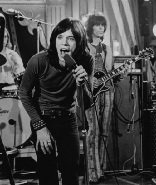 The Rolling Stones, Rock and Roll Circus. I'm obsessed with Keith Richard's pants. I've been wanting a pair just like them ever since I first saw them.