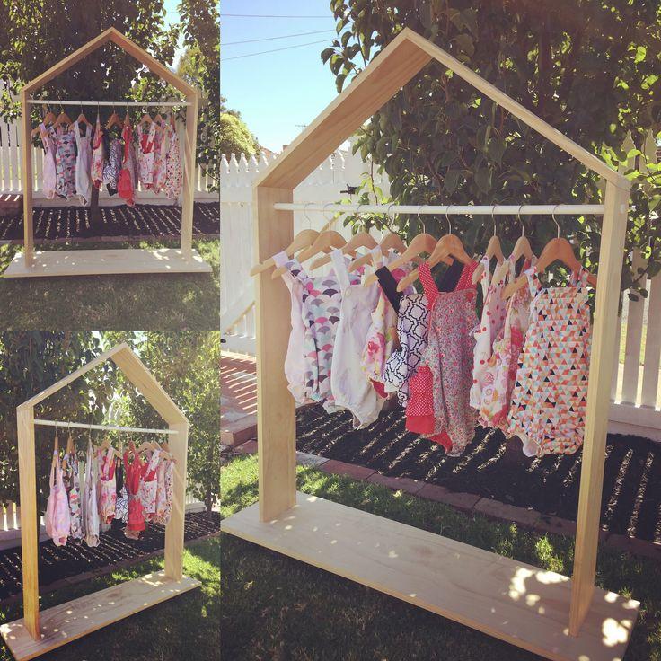Handmade clothing rack with handmade baby rompers BEAR+MOO+DO