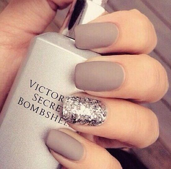 Love this matte taupe manicure with a silver glitter accent nail. Photo via Beauty There: