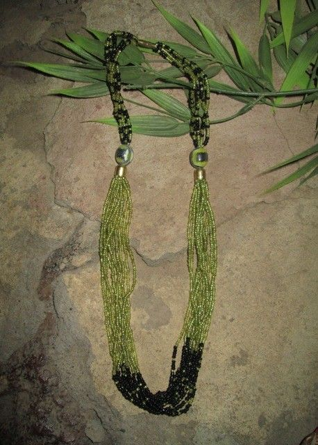 africanartonline.com - Multi Strand African Bead Necklace, A delicate hand crafted multi strand beaded necklace. Hand crafted at Meserani, East Africa. Green and black beads, with two featured wooden beads. Gold clasp Length: 27cm Ideal for casual or evening wear.$24.95 http://africanartonline.com/multi-strand-african-bead-necklace/