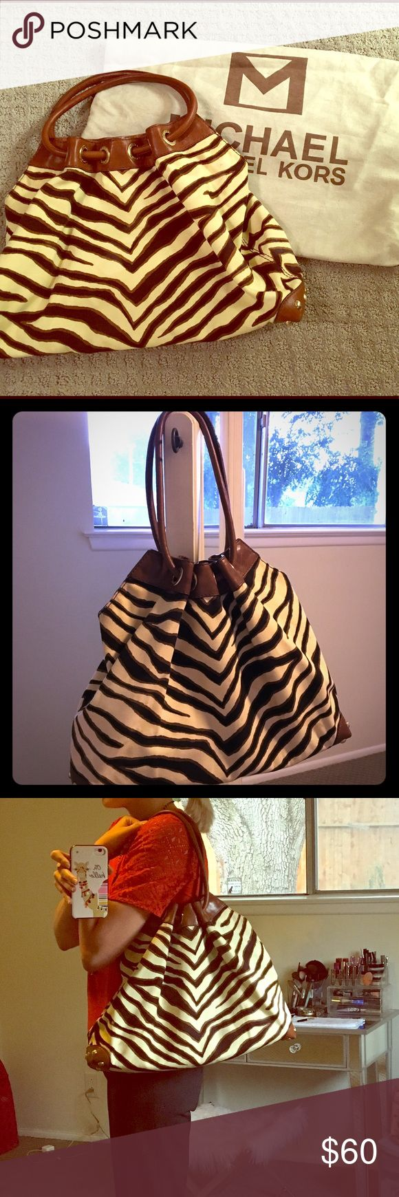 Michael Kors Joplin animal print purse Fun, unique canvas and leather shoulder bag. It has some stains on the canvas, but leather is in good condition. Please see pictures. Comes with dust bag. Offers made using the OFFER button will be considered. MICHAEL Michael Kors Bags Shoulder Bags