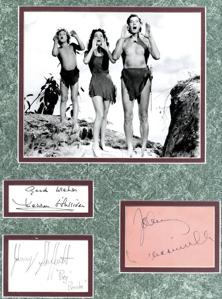 TARZAN: Individual signed cards and an album page by the actors Johnny Weissmuller (Tarzan), Maureen O'Sullivan (Jane) and Johnny Sheffield (Boy), matted in dusky pink and mottled green alongside each other and beneath a photograph of the three actors standing together in full length poses in costume from one of the Tarzan movies.