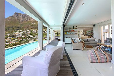 SEAFOAM, Llandudno Self Catering Accommodation in Cape Town - Spectacularly positioned, open plan villa, one row back from the beach and with stunning sea and mountain views.. 4 Bedrooms, 3 bathrooms, swimming pool, uncapped WiFi, satellite TV, serviced daily by Malawian houseman. Sleeps 8.