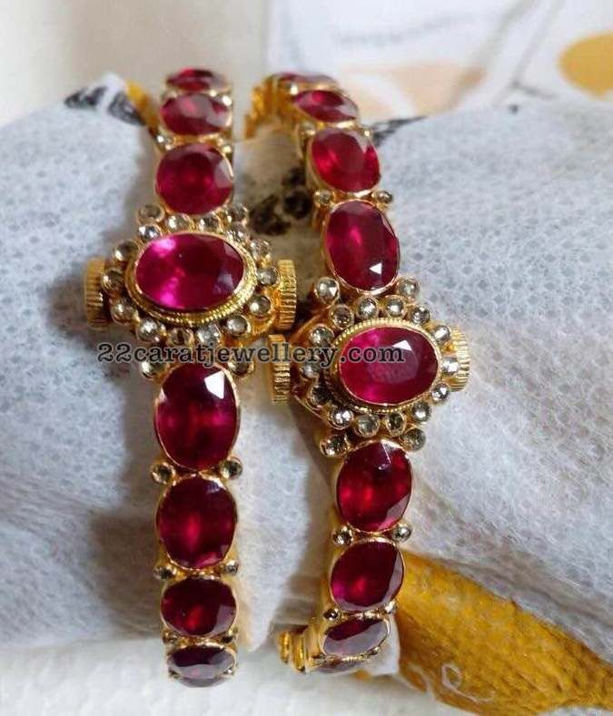 22 carat gold large pota rubies broad bangles with screw open style, Simple round uncut style stones surrounded by the rubies. Approxim...
