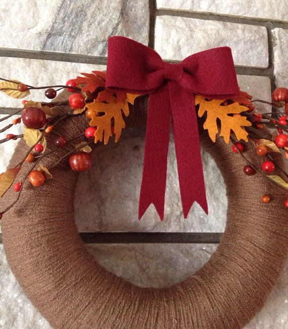 Fall yarn wreath with felt bow and floral picks