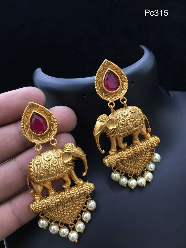 @katerinekosivchenko Gorgeous gold, ruby and pearl earrings with elephant details.