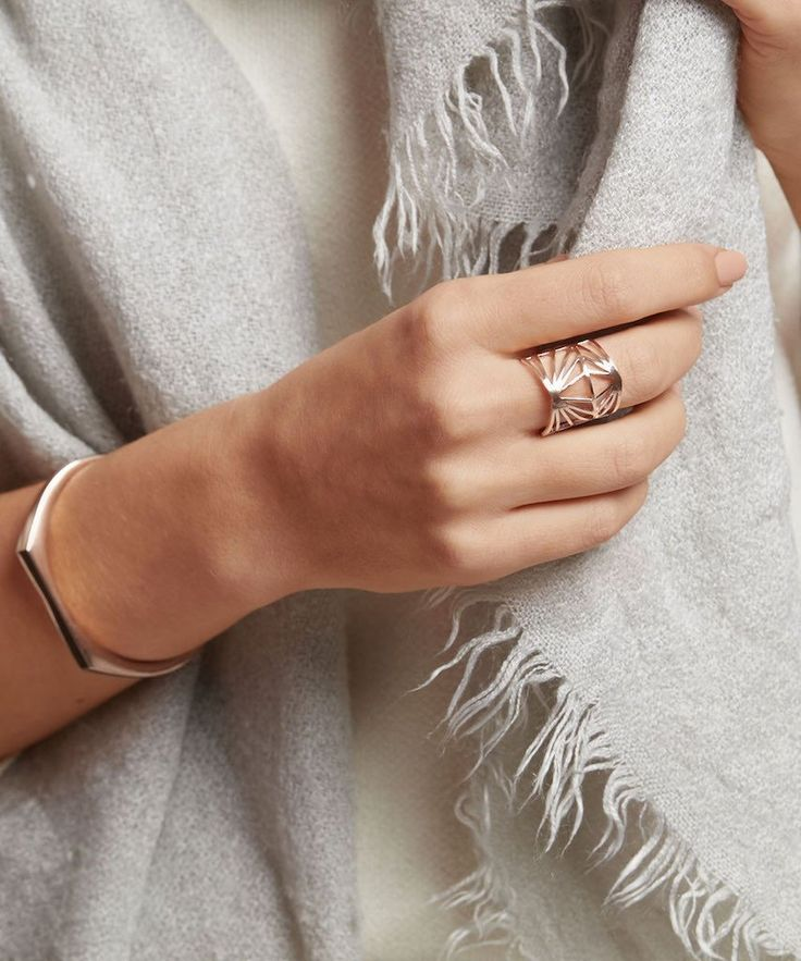 Our love for contemporary geometric patterns is stamped on this stunning statement cutout ring. The Ember Rose Ring plays with structural lines, 3D shapes and geometric chevrons. It is adjustable and