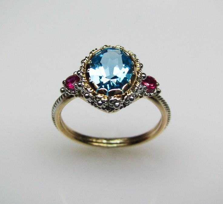 Blue Topaz & Ruby Ring - in 14K Gold by FernandoJewelry on Etsy https://www.etsy.com/listing/91126239/blue-topaz-ruby-ring-in-14k-gold