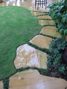 I love this garden path that is designed close and tight to the planting bed........Stepping Stone Walkway by Matthew Giampietro of Waterfalls Fountains & Gardens Inc. Teakwood Sandstone Flagstone