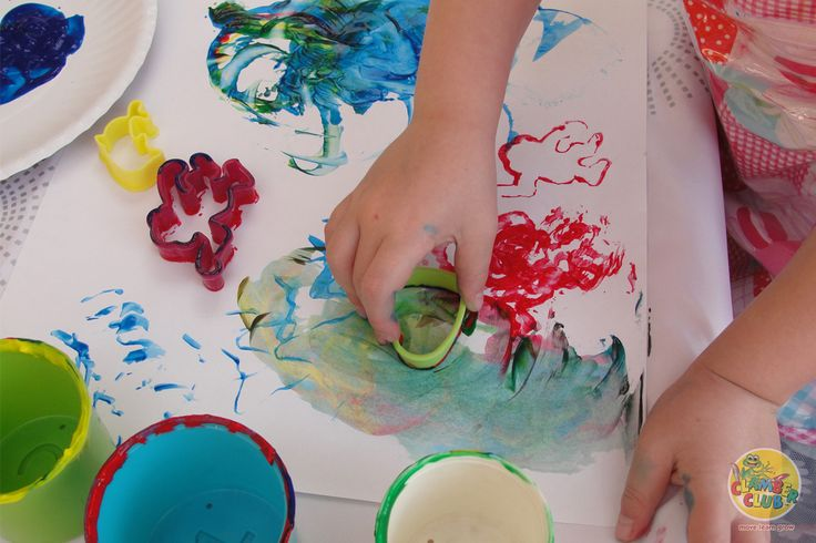 Instead of painting with your fingers and brushes introduce a new element and paint with shapes and stamps.