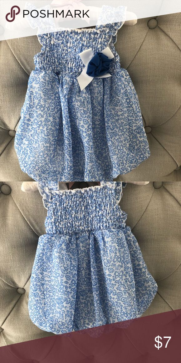 Super sweet blue and white bubble romper So cute! EUC blue and white smock top bubble romper with flower detail and snap closure at the bottom. Adorable for spring. Perfect for Easter One Pieces Bodysuits