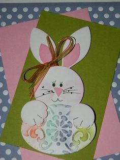 handmade Easter card .. punch art bunny ... love the oval cut egge with embossing folder texture sponged with pastel colors ...
