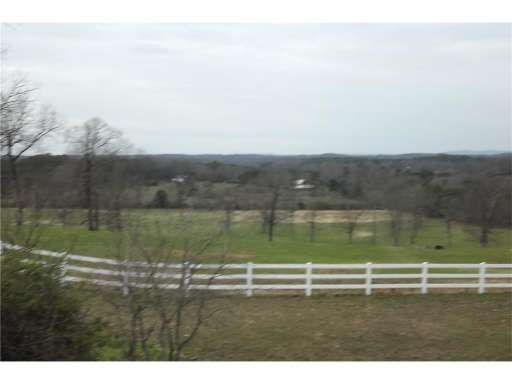 Beautiful country home with 36.40 acres in the Sonoraville School District.  Property is fenced  and crossed fence, has a large barn  at front of property, and a pond at back of property.  New Architectural  shingled roof just installed, new Geothermal heating & cooling system just installed, and a Generac home   backup generator which will provide the entire house with power until utility power is returned in case of outages.  The view from either the front porch or the covered back por...