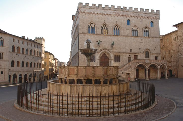 Perugia - Umbria Fontana Maggiore (The Great Fountain). The fountain stands in the central Piazza IV Novembre. Looking out over the square are the Priors' Palace, the Bishop's Palace and the Lawyers' Meeting Hall (Palazzo dei Notari). It was built in 1275.78 and designed by Fra' Bevignate