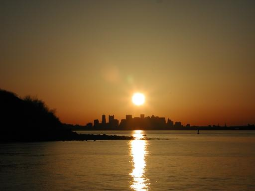 This is a simple yet beautiful sunset over a city... Not sure where. I love the warm glow effect it has.