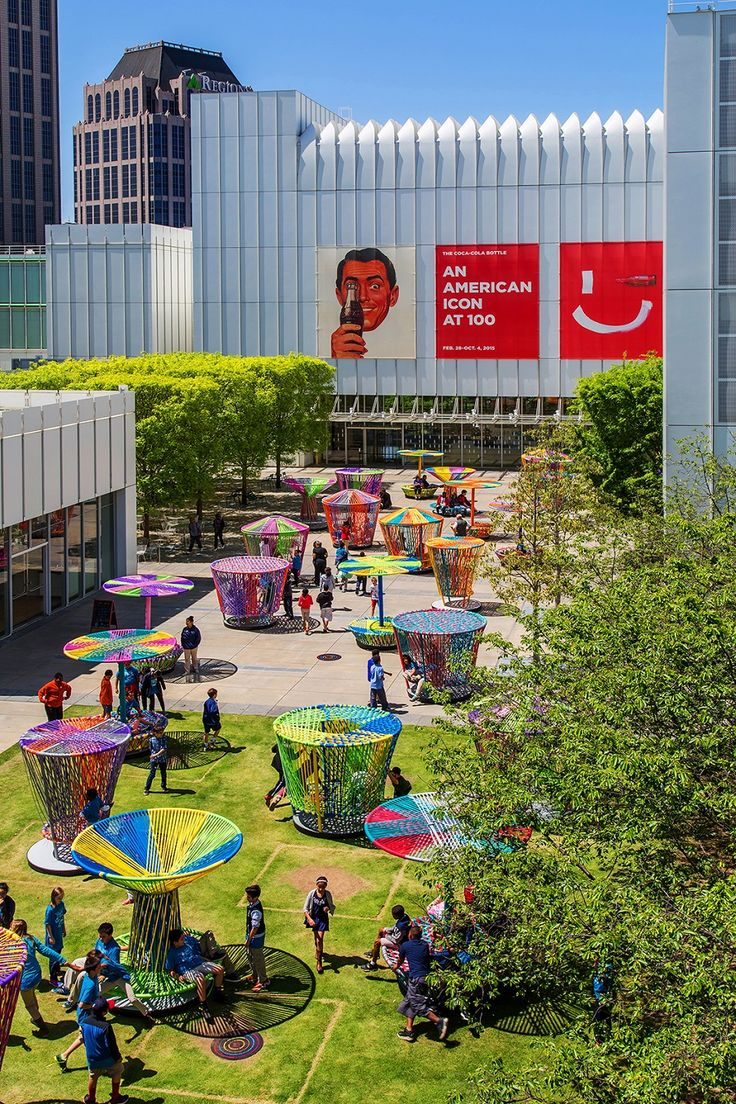 """Los Trompos"" (""The Spinning Tops"") - interactive installation for High Museum of Art / Mexican designers Héctor Esrawe and Ignacio Cadena. #PublicSpace #Design #Art #color #people #installation"