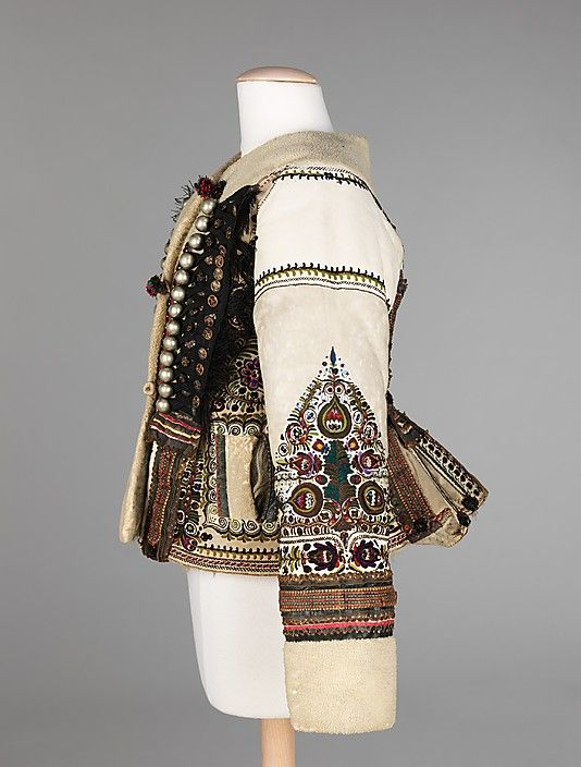 Hungarian, late 19th Century. Love the pleated back, military style braiding and buttons and the white space (see next image).
